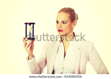 Young business woman holding hourglass.Time concept - stock photo