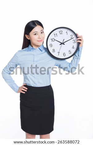 young business woman holding office clock, isolated on white background, time concept - stock photo