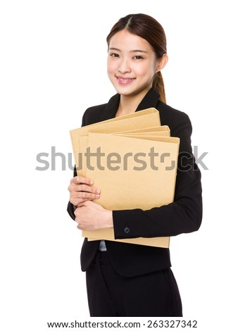 Young business woman holding report  - stock photo