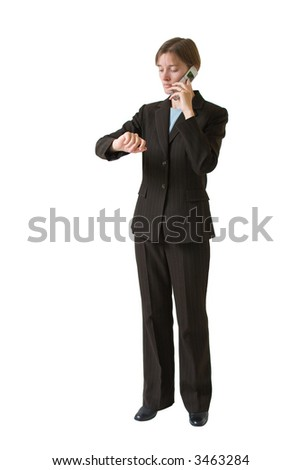 Young business woman in a tailored suit with cell phone. Image is isolated on a white background. - stock photo