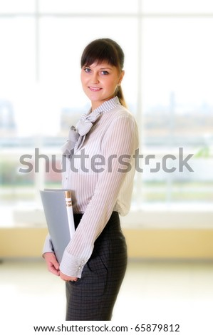 Young business woman in an office at the workplace.