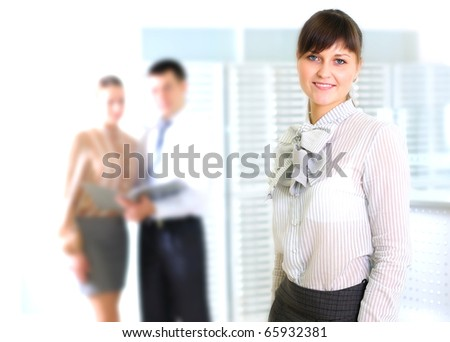 Young business woman in an office at the workplace. - stock photo