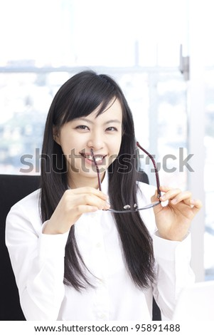 Young business woman in eye glasses - stock photo
