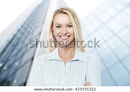 Young business woman in front of office building - stock photo