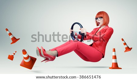 Young business woman in glasses driver car with a wheel, woman on the road