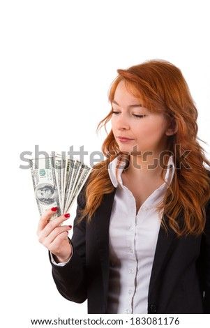 Young business woman in suit looking at money, isolated on white background.