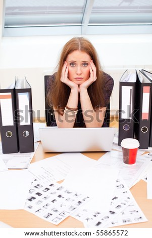 young business woman is suffering from burn-out syndrome - stock photo