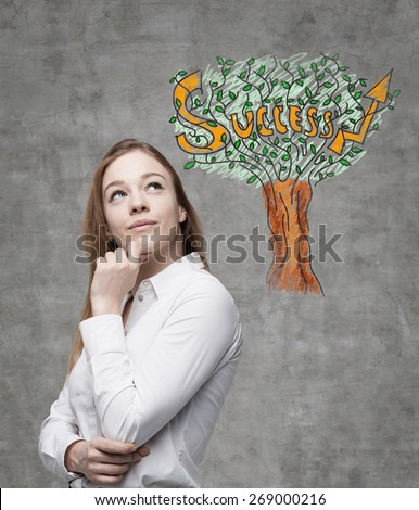 Young business woman is thinking of success way. A concept of success. - stock photo