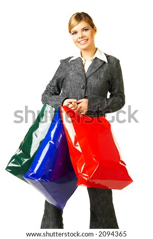 Young business woman isolated on white background with shopping bags