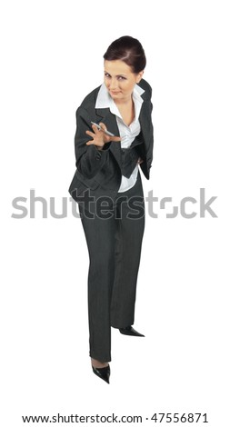 Young business woman looking directly into the camera and stands in a joking posture - stock photo