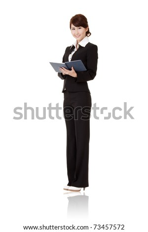 Young business woman of Asian holding book and smiling, full length portrait isolated on white background.