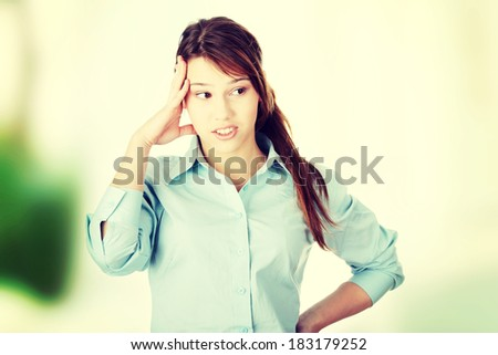 Young business woman or student - thinking, - stock photo