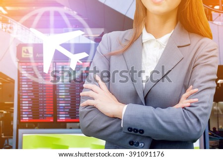 young business woman over flight schedule in airport background ,abstract background to travel concept. - stock photo