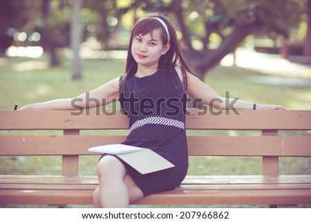 Young business woman planing, writing and reviewing report at city park. - stock photo