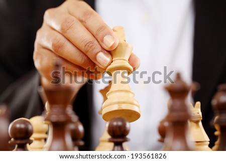 Young business woman playing chess -The king is checkmated - stock photo