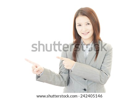 Young business woman pointing