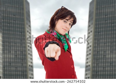 young business woman pointing, at the office - stock photo