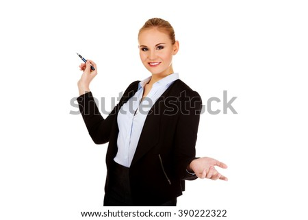 Young business woman pointing for copyspace or board - stock photo