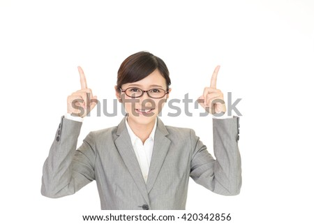 Young business woman pointing upward - stock photo