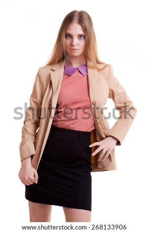 Young business woman posing in studio in fashion style - stock photo