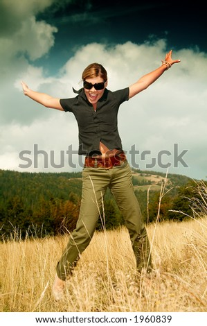 Young business woman relaxing on mountain meadow