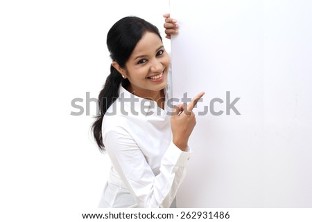 Young business woman showing blank signboard - stock photo