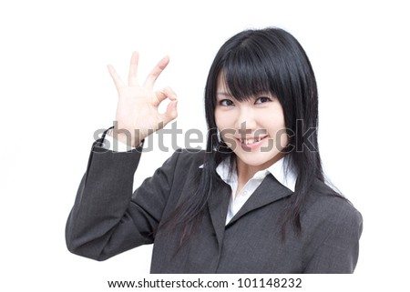 young business woman showing OK sign, isolated on white background - stock photo