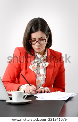 Young business woman signing a document