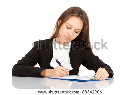 young business woman sitting on her desk writing, sign up contract isolated over white background - stock photo