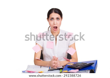 Young business woman sitting stressed in office with reminder stickers on her shirt. Frustration at work. Time management. Isolated. - stock photo