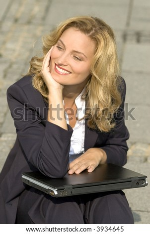 Young business woman sitting with a laptop