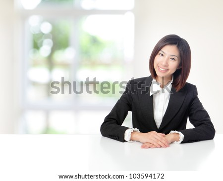 Young Business woman smile face close up and sit at company office with white table, window outside are green background, model is a asian beauty - stock photo
