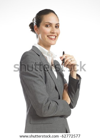young business woman smiling and holding pen - stock photo