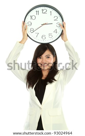 young business woman smiling holding a big clock - stock photo