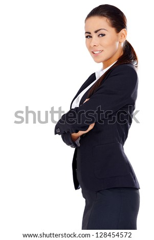 Young business woman standing with arms crossed, isolated on white background - stock photo