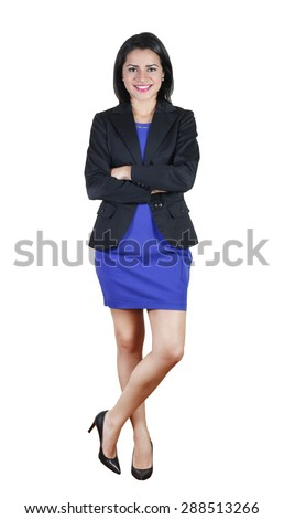 Young business woman standing with her arms crossed - stock photo