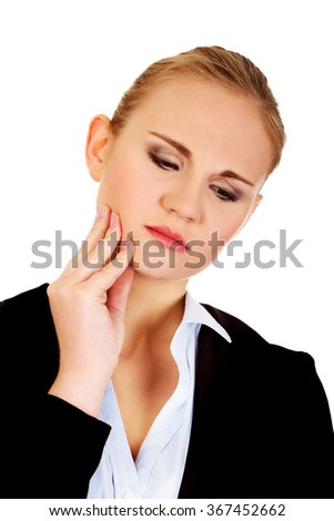 Young business woman suffering from tooth ache - stock photo