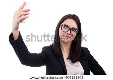 young business woman taking selfie photo with smart phone isolated on white background - stock photo