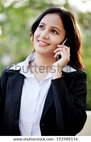 Young business woman talking on mobile smart phone at outdoors