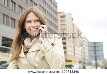 Young business woman talking on the phone, Berlin, Germany