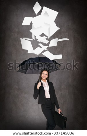 Young business woman throws up paper sheets. Vacation concept