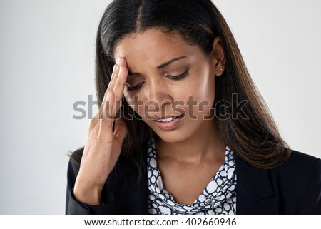 Young business woman tired stressful suffering from bad headache and fatigue - stock photo