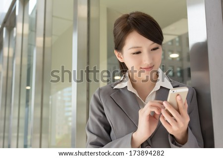 Young business woman use cellphone, closeup portrait. - stock photo