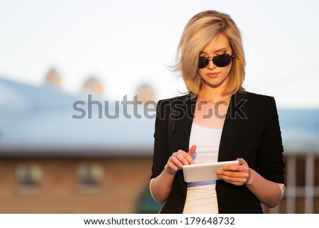 Young business woman using a digital tablet computer - stock photo