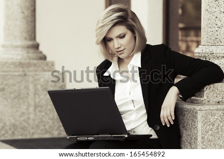 Young business woman using laptop - stock photo