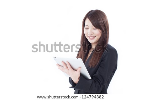 Young business woman using tablet computer, isolated on white background - stock photo