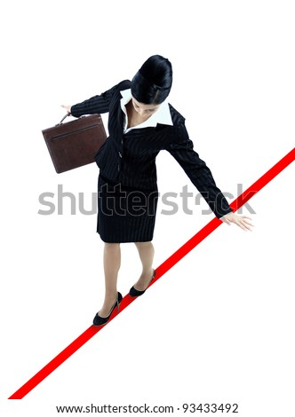 young business woman walking on a tightrope nearly falling on white background