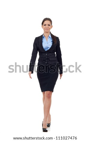 Young business woman walking towards camera. isolated over a white background