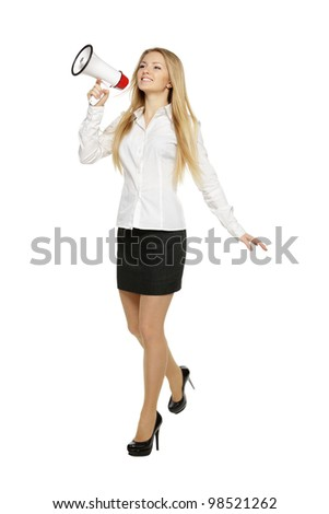 Young business woman walking with megaphone, over white background
