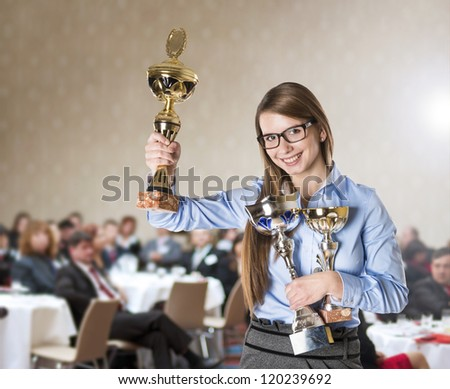 Young business woman was awarded on corporate conference. - stock photo